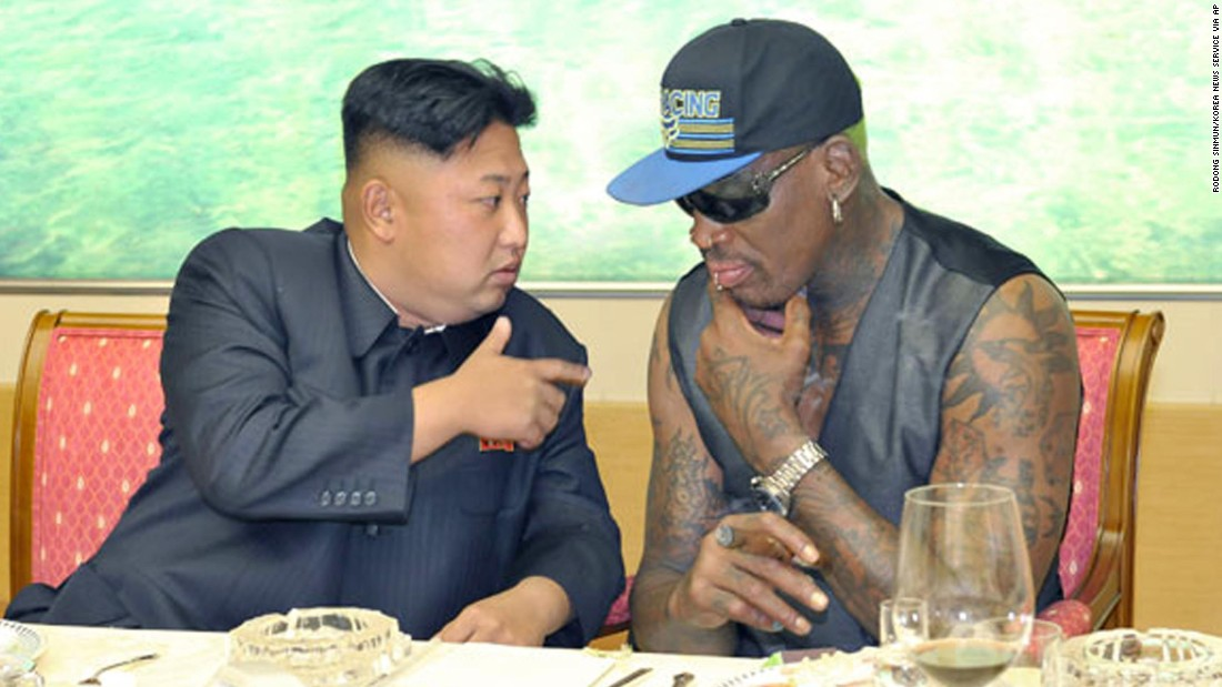 Kim talks with Rodman during a dinner in this undated photo published on the homepage of North Korea's Rodong Sinmun newspaper on September 7, 2013.