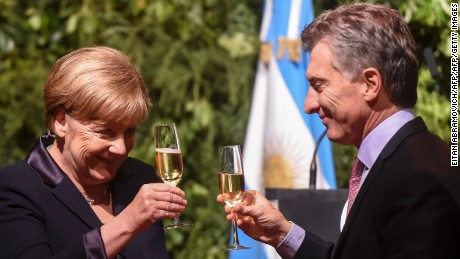 German Chancellor Angela Merkel (L) and Argentinian President Mauricio Macri toast to each other during a state dinner at the Kirchner Cultural Centre in Buenos Aires on June 8, 2017. Germany and Argentina voiced hopes Thursday for a free trade agreement between the European Union and South America as German Chancellor Angela Merkel visited Buenos Aires. / AFP PHOTO / EITAN ABRAMOVICH        (Photo credit should read EITAN ABRAMOVICH/AFP/Getty Images)
