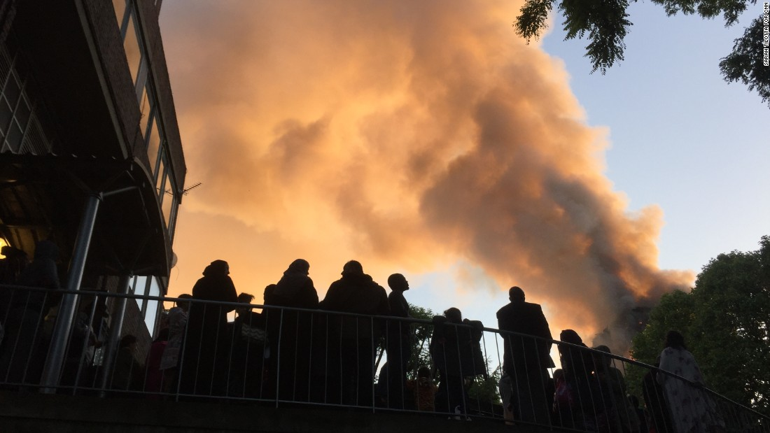 Residents of Whitchurch Road watch smoke streaming from the tower.