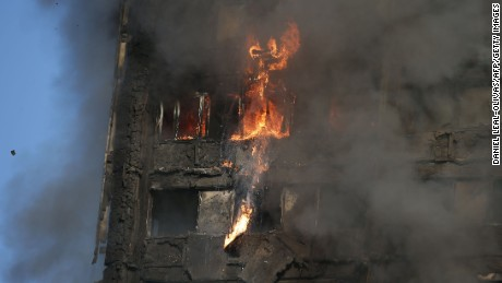 "Fire rips through Grenfell Tower as firefighters attempt to control a huge blaze on June 14, 2017 in west London.  The massive fire ripped through the 27-storey apartment block in west London in the early hours of Wednesday, trapping residents inside as 200 firefighters battled the blaze. Police and fire services attempted to evacuate the concrete block and said ""a number of people are being treated for a range of injuries"", including at least two for smoke inhalation.   / AFP PHOTO / Daniel LEAL-OLIVAS        (Photo credit should read DANIEL LEAL-OLIVAS/AFP/Getty Images)"