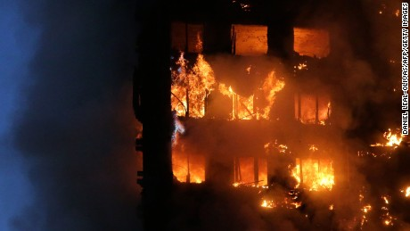"Flames and smoke engulf Grenfell Tower, a residential block on June 14, 2017 in west London.  The massive fire ripped through the 27-storey apartment block in west London in the early hours of Wednesday, trapping residents inside as 200 firefighters battled the blaze. Police and fire services attempted to evacuate the concrete block and said ""a number of people are being treated for a range of injuries"", including at least two for smoke inhalation.   / AFP PHOTO / Daniel LEAL-OLIVAS        (Photo credit should read DANIEL LEAL-OLIVAS/AFP/Getty Images)"