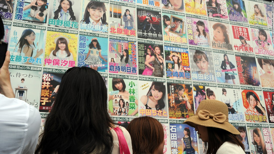 AKB48 fans watch the election campaign posters prior to the group's general election announcement in 2013.