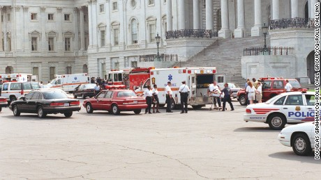 Tourists leave the Capitol on a stretcher after the violence and chaos caused by the shootings that claimed the lives of US Capitol Police officers John Gibson and Jacob J. Chestnut in 1998.