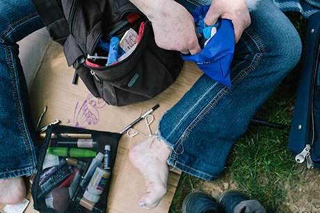 A woman opens an opioid overdose rescue kit in McPherson Square Park in Philadelphia.