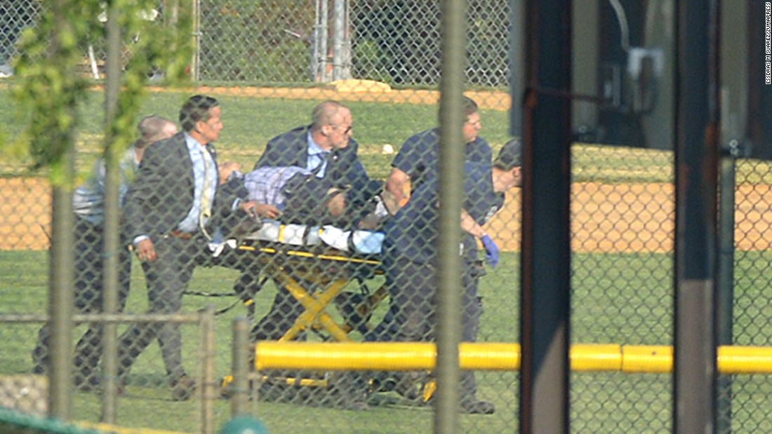 A wounded person is stretchered away from a baseball field in Alexandria, Virginia, on Wednesday, June 14. A gunman opened fire on Republican congressmen as they practiced baseball at the field. House Majority Whip Steve Scalise, a congressional staffer, a lobbyist and two members of the congressional police force were among those injured, officials said. The alleged gunman was killed.