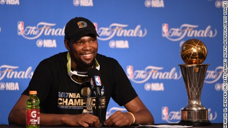 OAKLAND, CA - JUNE 12:  Kevin Durant #35 of the Golden State Warriors speaks at the press conference after his teams 129-120 victory over the Cleveland Cavaliers in Game 5 to win the 2017 NBA Finals at ORACLE Arena on June 12, 2017 in Oakland, California. NOTE TO USER: User expressly acknowledges and agrees that, by downloading and or using this photograph, User is consenting to the terms and conditions of the Getty Images License Agreement.  (Photo by Thearon W. Henderson/Getty Images)