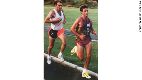 Running with the Mind coach Marty Kibiloski, right, runs a race at 31 years old. He's now 57.