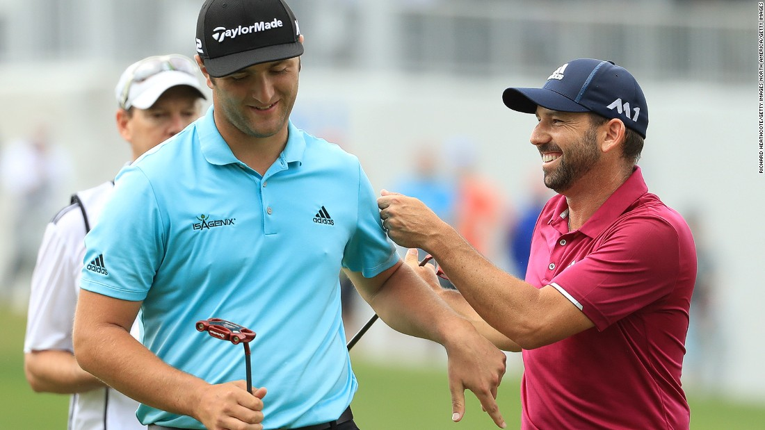 Rahm enjoys a joke with fellow Spaniard Sergio Garcia who finally clinched his first major title at the Masters tournament in April.