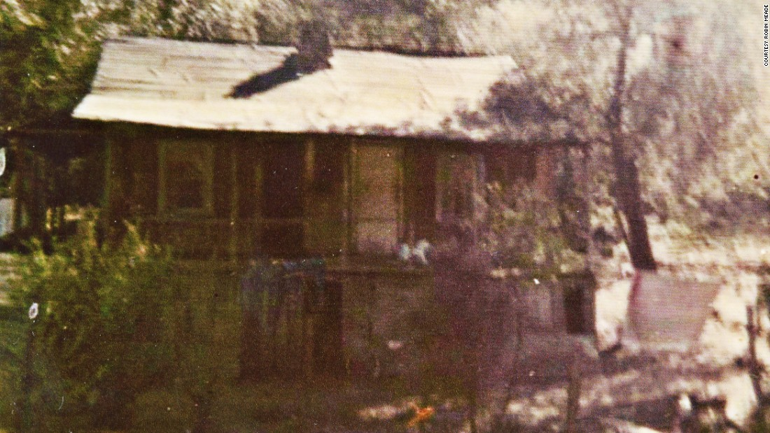 This is the house where Linro Meade was born, built by hand by his father on rented land using no modern machinery. The chimney was made from rocks and clay mortar and the lumber is rough sawn. It was never painted and had no running water or heat, with the exception of a small fireplace.