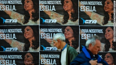 "Wall posters of the Argentine Workers' Center reading ""For Us It's Her"" referring to former Argentine President (2007-2015) Cristina Kirchner, are seen in downtown Buenos Aires, Argentina on June 14, 2017. The Argentinian opposition has not yet revealed if Cristina Kirchner will run for senator or deputy in next October legislative elections. / AFP PHOTO / EITAN ABRAMOVICH        (Photo credit should read EITAN ABRAMOVICH/AFP/Getty Images)"