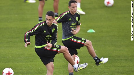 Mexico's national football team forward Javier Hernandez (L) and midfielder Andres Guardado (R) attend a training session ahead of the 2017 FIFA Confederations Cup football tournament, in Kazan on June 15, 2017. / AFP PHOTO / YURI CORTEZ        (Photo credit should read YURI CORTEZ/AFP/Getty Images)