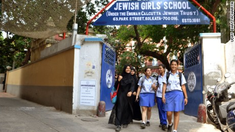 Muslim girls, some in the burqa and some in the regular uniforms, leave the Jewish Girls School in Calcutta.