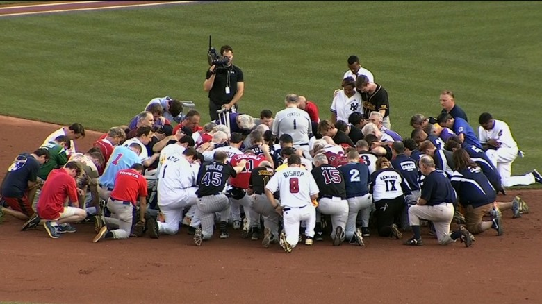 Teams pray before baseball game