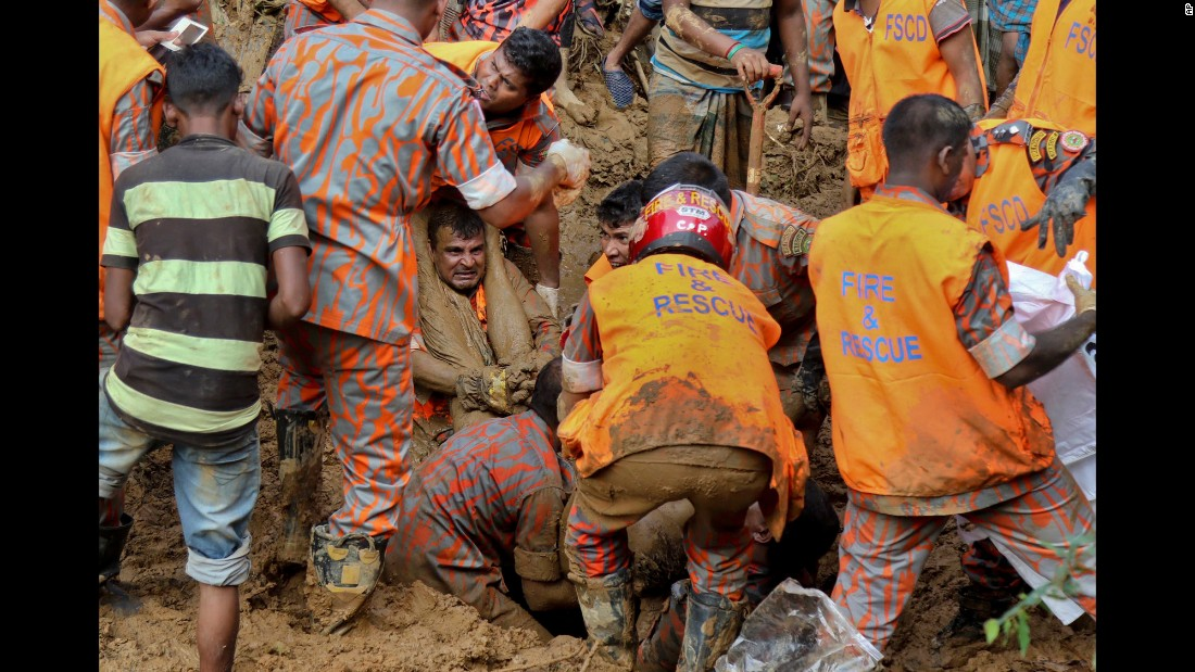 "Rescuers pull out bodies Wednesday, June 14, after a massive landslide in Bangladesh's Rangamati district. Heavy overnight rains <a href=""http://www.cnn.com/2017/06/13/asia/bangladesh-landslides/index.html"" target=""_blank"">triggered a series of landslides</a> in southeast Bangladesh, killing at least 133 people and injuring many more, officials said."