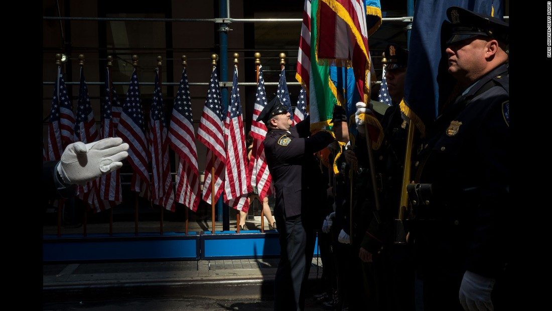 Members of the New York City Police Department prepare for the opening ceremony of a new 9/11 Tribute Museum on Tuesday, June 13.
