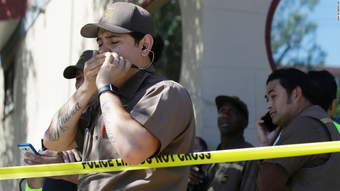 "UPS workers gather outside a package delivery warehouse where <a href=""http://www.cnn.com/2017/06/14/us/san-francisco-shooting/index.html"" target=""_blank"">a deadly shooting</a> took place in San Francisco on Wednesday, June 14. A gunman killed three men at the facility and then himself. Two others were shot but survived."