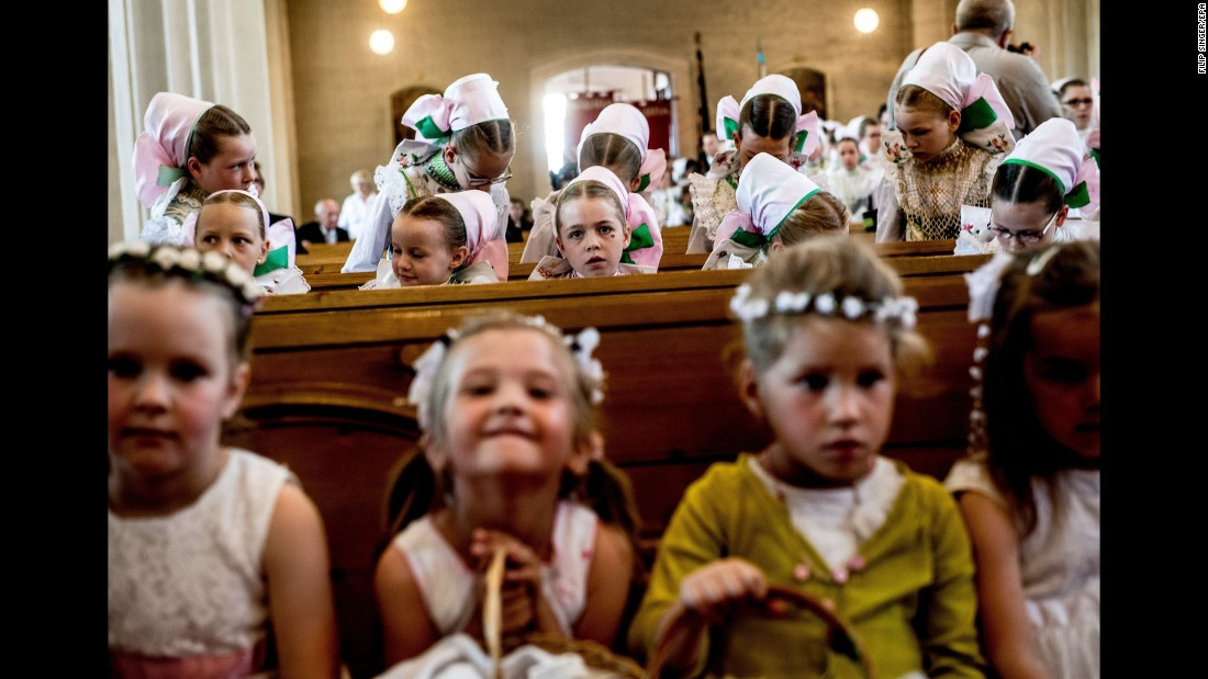 Children attend a Catholic Mass during a Corpus Christi procession in Crostwitz, Germany, on Thursday, June 15.