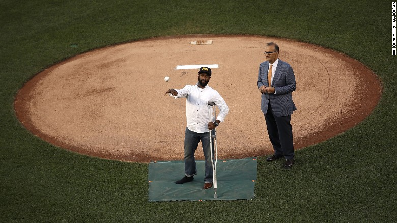 Wounded officer throws out first pitch