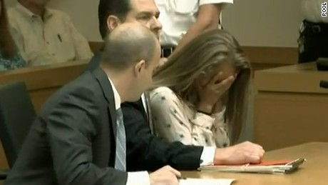 Michelle Carter reacts as the judge explains his rationale for his guilty finding in her manslaughter case.