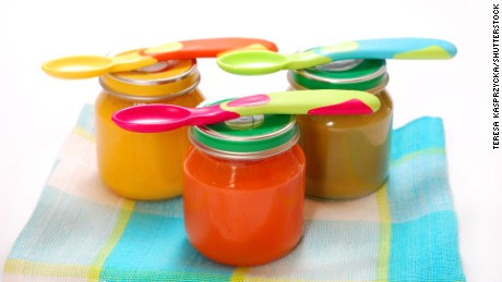 jars of various baby food and spoons isolated on white; Shutterstock ID 64642279; PO: Lead in Baby Food - Health Request