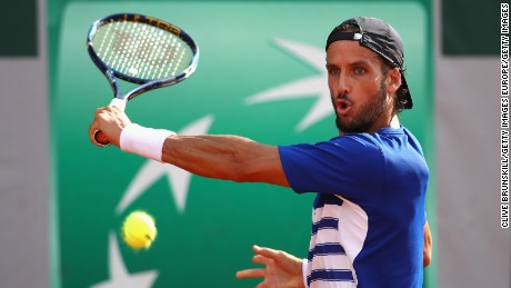 PARIS, FRANCE - MAY 29:  Feliciano Lopez of Spain plays a backhand during the mens singles first round match against Bjorn Fratangelo of The United States on day two of the 2017 French Open at Roland Garros on May 29, 2017 in Paris, France.  (Photo by Clive Brunskill/Getty Images)
