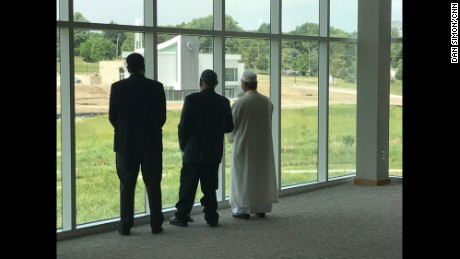 The three faith leaders look out on the former golf course, now the home of the Tri-Faith campus.