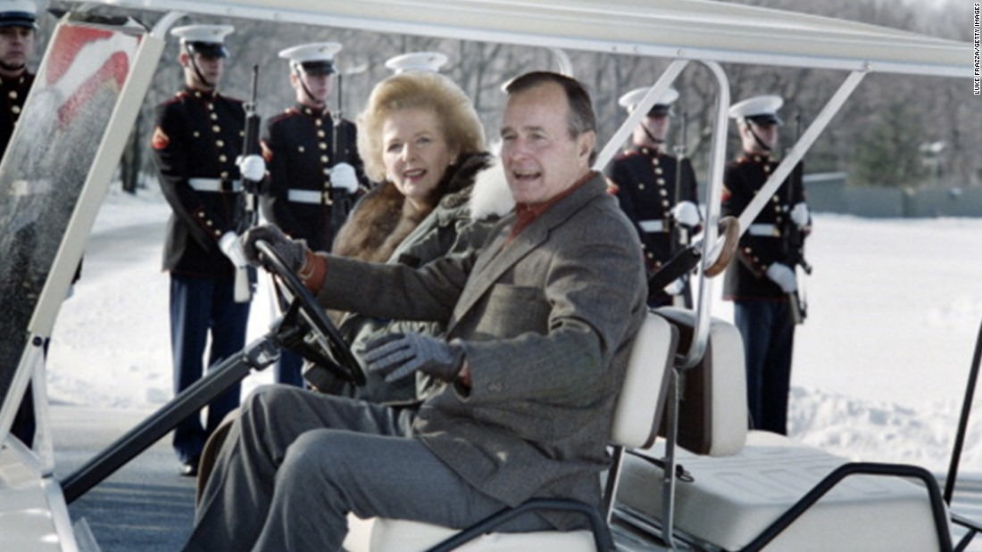 President George H.W. Bush takes British Prime Minister Margaret Thatcher for a spin in his golf cart in November 1989.