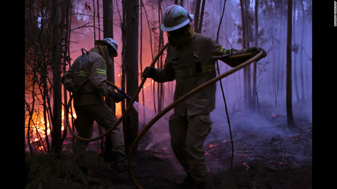 Portuguese National Republican Guard firefighters work to stop the fire from reaching the village of Avelar.
