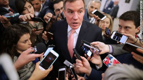 WASHINGTON, DC - MAY 16:  Reporters surround Senate Intelligence Committee ranking member Sen. Mark Warner (D-VA) as he heads for his party's weekly policy luncheon at the U.S. Capitol May 16, 2017 in Washington, DC. Many Republican and Democratic senators expressed frustration and concern about how President Donald Trump may have shared classified intelligence with the Russian foreign minister last week at the White House.  (Photo by Chip Somodevilla/Getty Images)