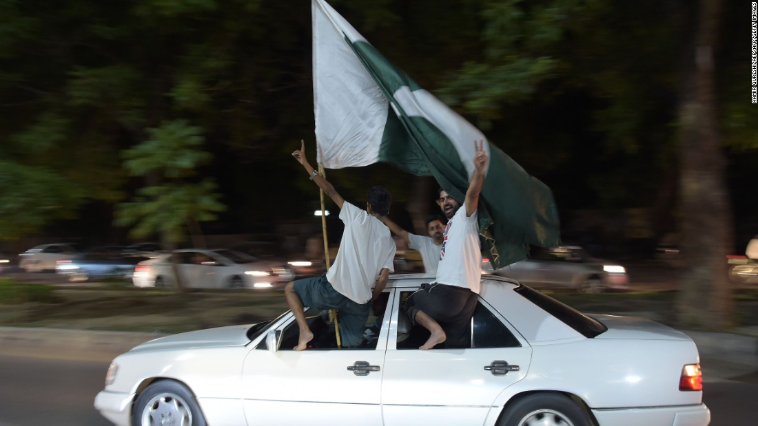 In Pakistan's capital Islamabad, cricket fans waved their national flag as they celebrated through the night.