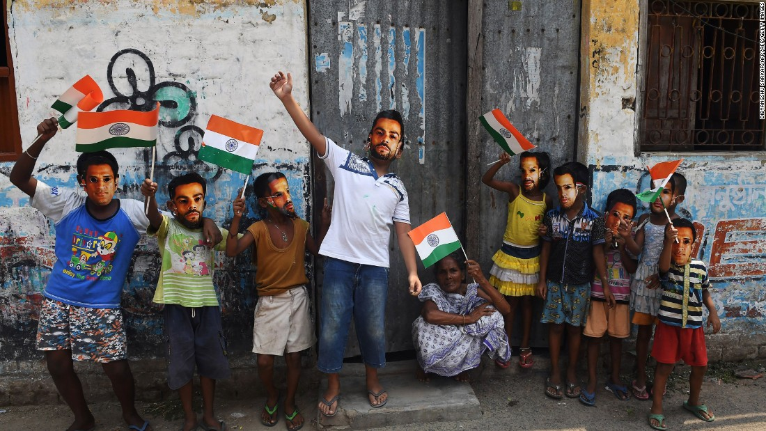 Young Indian cricket fans in Kolkata, West Bengal -- wearing face masks of their favorite players, including India's captain Virat Kohli -- were full of hope for the defending champions.