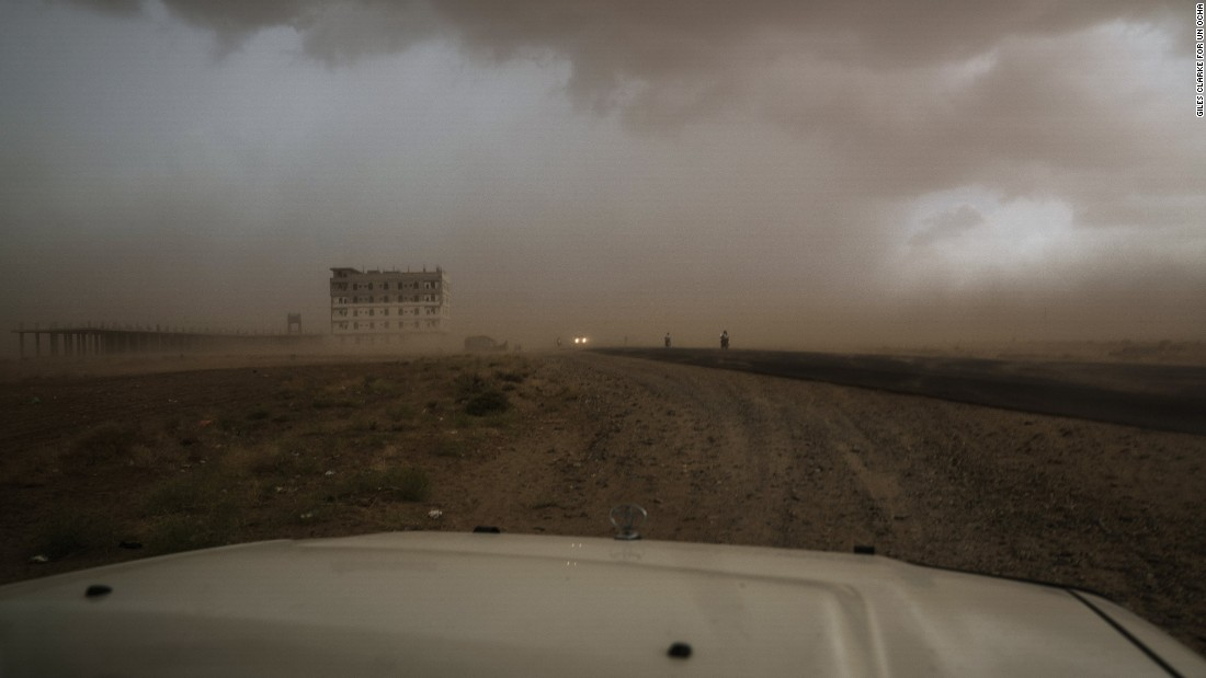 A sandstorm barrels across the landscape near Abs, a sprawling settlement for  internally displaced people in Yemen. The UN Office for the Coordination of Humanitarian Affairs (OCHA) says more than 3 million Yemenis are displaced.
