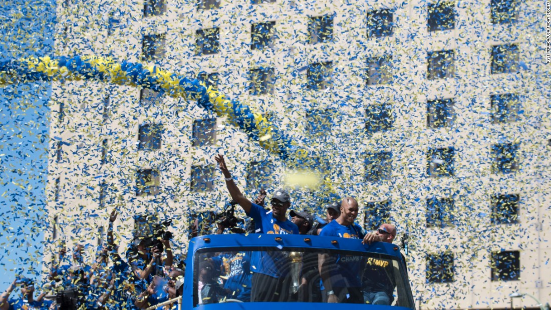 "Kevin Durant waves to the crowd in Oakland, California, during the Golden State Warriors' victory parade on Thursday, June 15. Durant was the NBA Finals' most valuable player as <a href=""http://www.cnn.com/2017/06/02/sport/gallery/nba-finals/index.html"" target=""_blank"">the Warriors defeated Cleveland</a> to win their second title in three seasons."