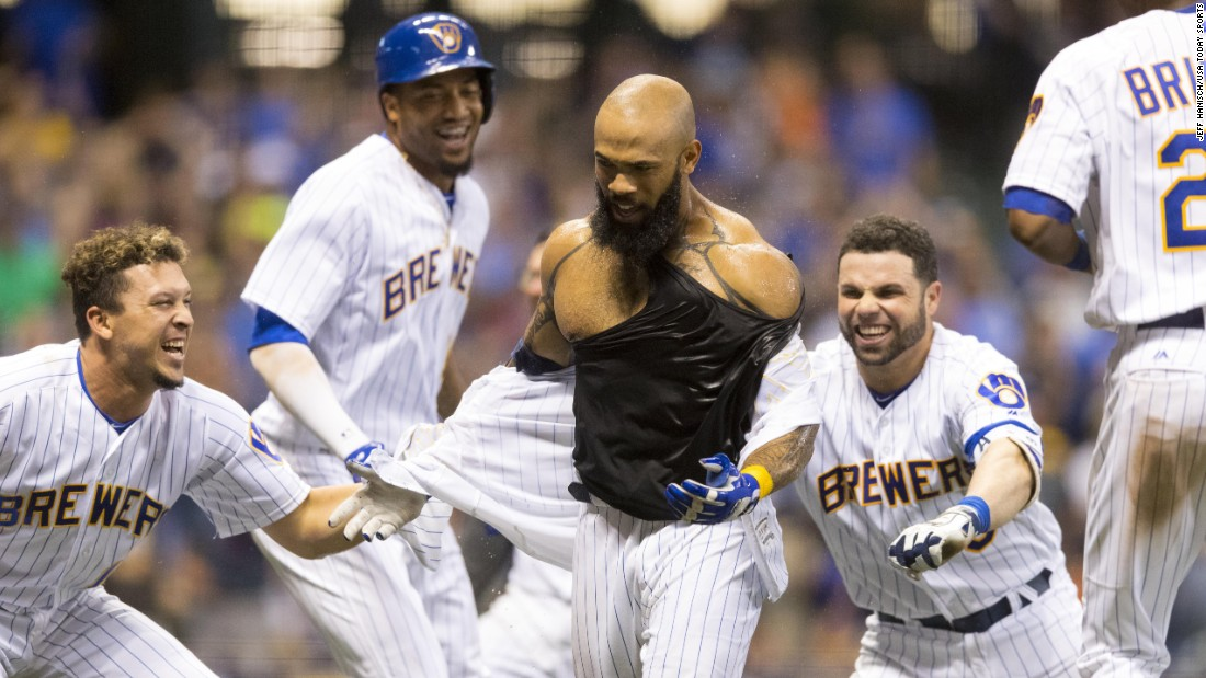 Eric Thames has his jersey ripped off by his Milwaukee teammates after his walk-off home run against San Diego on Friday, June 16.