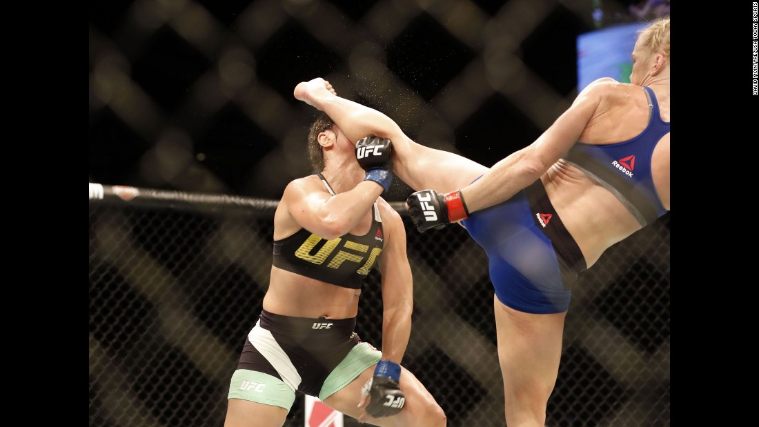 Holly Holm knocks out Bethe Correia with a head kick during their UFC fight in Singapore on Saturday, June 17. It was Holm's first win since knocking out Ronda Rousey in 2015.