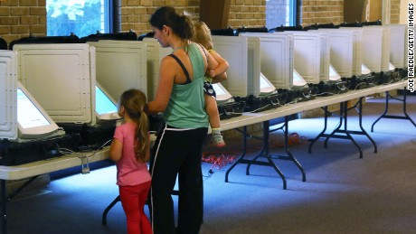 TUCKER, GA - JUNE 20:  Michele Parsons casts her ballot with her children Maria Parsons (L) and Maya Parsons during a special election in Georgia's 6th Congressional District special election at St. Bede's Episcopal Church on June 20, 2017 in Tucker, Georgia. Democratic candidate Jon Ossoff and Republican candidate Karen Handel are running to replace Tom Price, who is now the Secretary of Health and Human Services. The election will fill a congressional seat that has been held by a Republican since the 1970s.  (Photo by Joe Raedle/Getty Images)