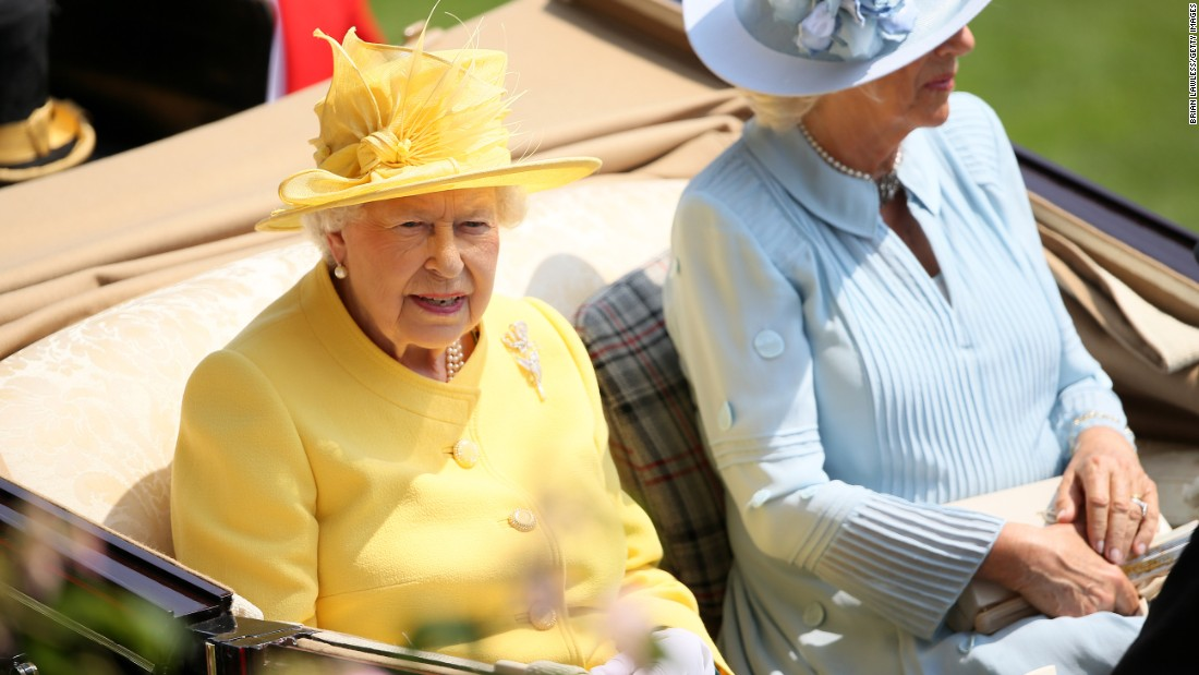 Britain's Queen Elizabeth II dashed from the State Opening of Parliament to take her place in the Royal Procession alongside Camilla, the Duchess of Cornwall, on day two of Royal Ascot.