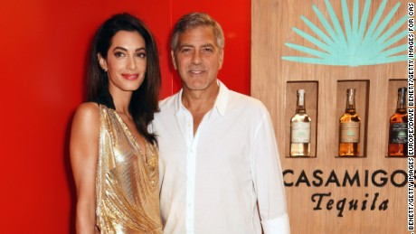 IBIZA, SPAIN - AUGUST 23:  Amal Clooney (L) and Founder of Casamigos Tequila George Clooney attend as Casamigos founders Rande Gerber, George Clooney and Mike Meldman host the official launch of Casamigos Tequila in Ibiza and Spain at Ushuaia Ibiza Beach Hotel on August 23, 2015 in Ibiza, Spain.  (Photo by David M. Benett/Dave Benett/Getty Images for Casamigos Tequila)