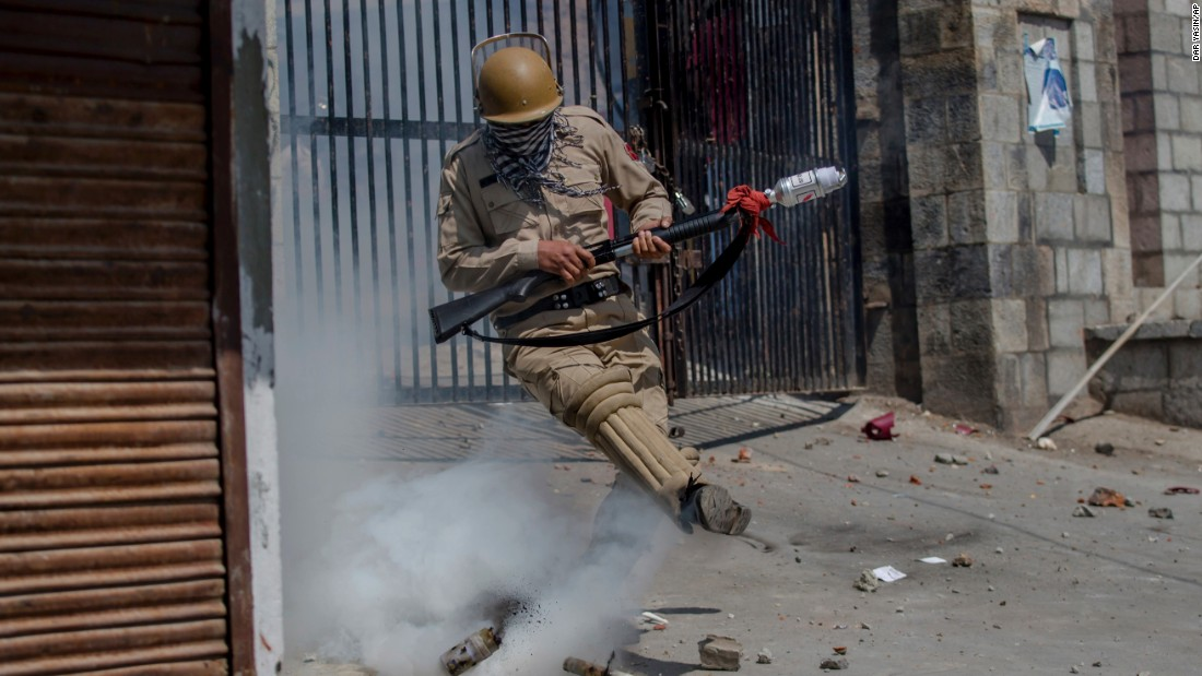 "A police officer kicks a tear-gas shell during clashes with Kashmiri protesters in Srinagar, India, on Friday, June 16. <a href=""http://www.cnn.com/2016/09/30/asia/kashmir-explainer/"" target=""_blank"">Read more: The Kashmir dispute explained</a>"