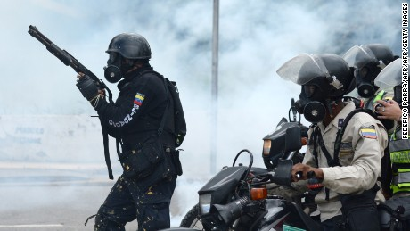 Police in riot gear charge on opposition activists during an anti-government protest in Caracas, on June 22, 2017. / AFP PHOTO / Federico Parra        (Photo credit should read FEDERICO PARRA/AFP/Getty Images)