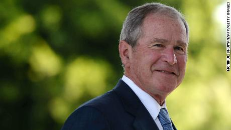 Former United States of America President George W. Bush looks on upon his arrival at the Theresanyo Primary school, on April 4, 2017, in Gaborone, during a two day official visit in Botswana.
