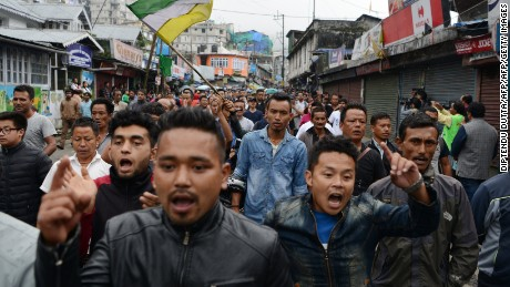 Indian supporters of the separatist Gorkha Janmukti Morcha (GJM) group shout slogans while demonstrating during an indefinite strike called in Darjeeling on June 19, 2017.