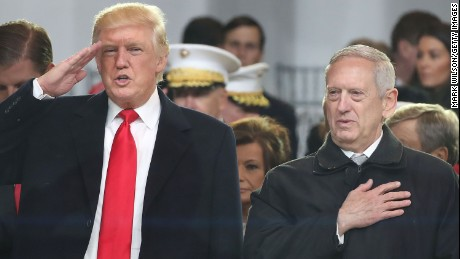 President Donald Trump stands with with Secretary of Defense nominee Gen. James Mattis Ret. as a parade passes the inaugural parade reviewing stand in front of the White House on January 20, 2017 in Washington, DC.