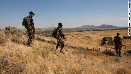 "Israeli soldiers patrol near the border with Syria after projectiles fired from the war-torn country hit the Israeli occupied Golan Heights on June 24, 2017. An Israeli aircraft carried out a strike on Syria after 10 projectiles hit the occupied Golan Heights, an army spokesman said. The Israeli Air Force also targeted two tanks of the ""Syrian regime"" in the northern part of the Golan, the spokesman said, adding the projectiles did not cause any casualties."