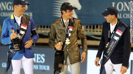 Italy's Alberto Zorzi celebrates on the podium at the Global Champions Tour event in Monaco, flanked by Christian Ahlmann (left) and Kevin Staut.