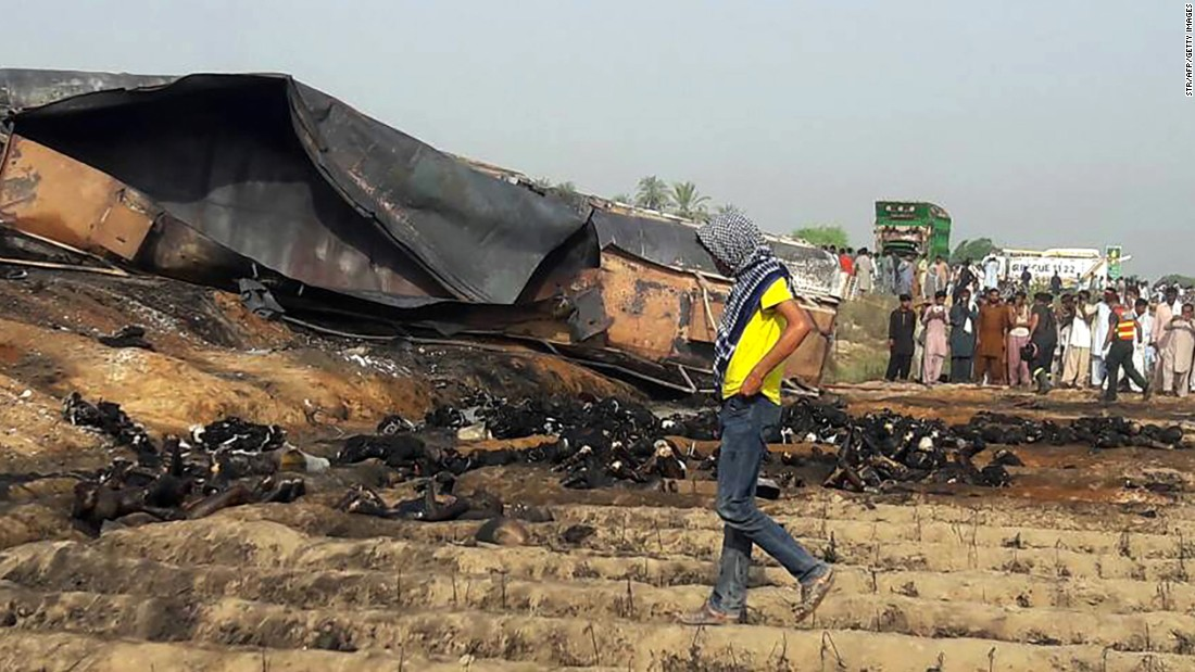 Burned bodies are strewn around the wreckage of the tanker.