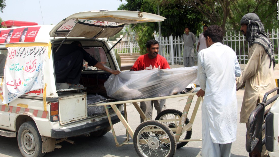 Victims are loaded onto a stretcher outside a hospital in Bahawalpur, Pakistan.