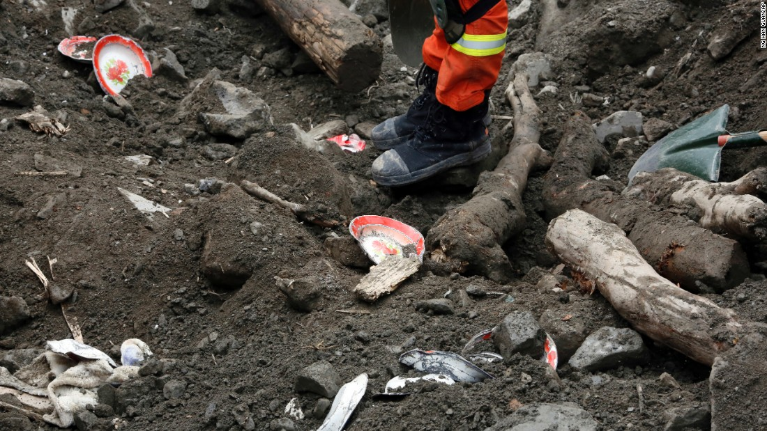Household goods are scattered among the debris as rescue workers search for victims on June 25.