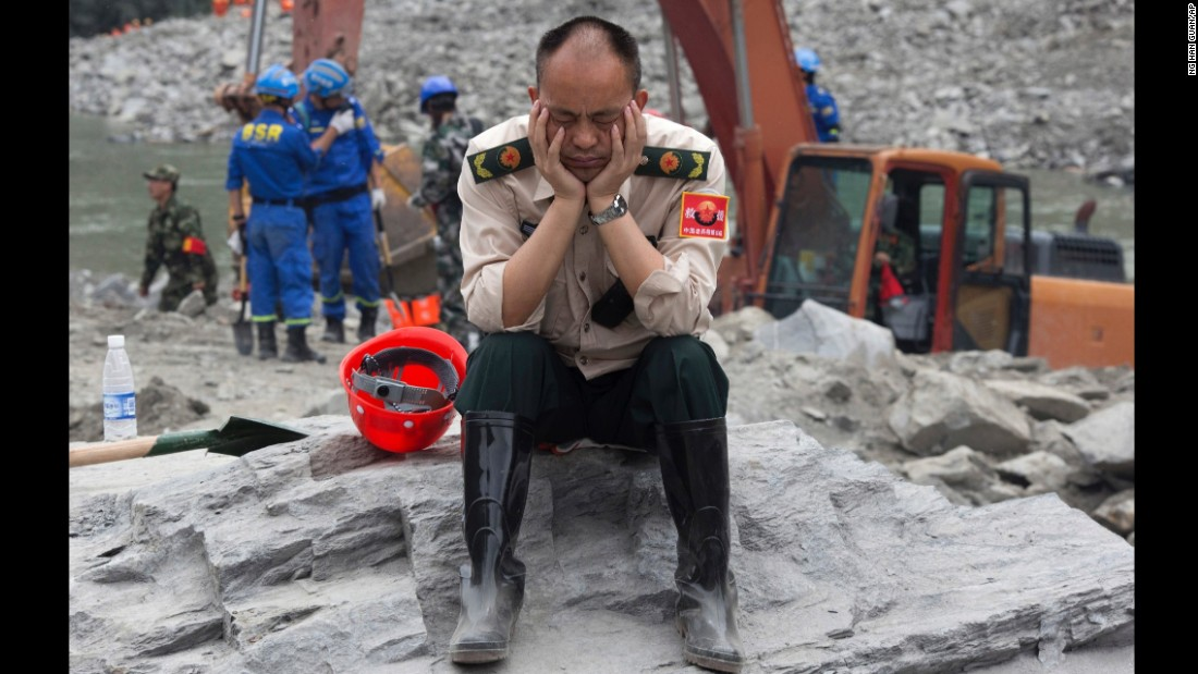 A rescue worker takes a nap on June 25.