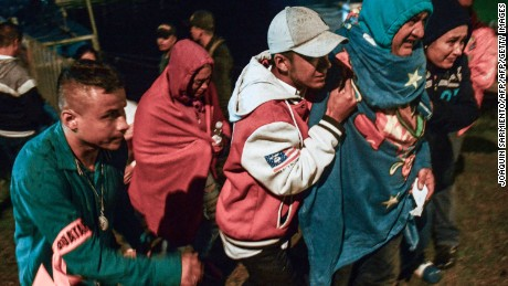 CORRECTION - Survivors clad in blankets arrive onshore after being rescued from the tourist boat Almirante in the Reservoir of Penol in Guatape municipality in Antioquia on June 25, 2017. At least nine people were dead and 28 missing after a tourist boat sank in a reservoir in northwestern Colombia on June 25, a regional official said. / AFP PHOTO / Joaquin SARMIENTO / The erroneous mention[s] appearing in the metadata of this photo by  has been modified in AFP systems in the following manner: [adding in byline Joaquin Sarmiento]. Please immediately remove the erroneous mention[s] from all your online services and delete it (them) from your servers. If you have been authorized by AFP to distribute it (them) to third parties, please ensure that the same actions are carried out by them. Failure to promptly comply with these instructions will entail liability on your part for any continued or post notification usage. Therefore we thank you very much for all your attention and prompt action. We are sorry for the inconvenience this notification may cause and remain at your disposal for any further information you may require.        (Photo credit should read JOAQUIN SARMIENTO/AFP/Getty Images)